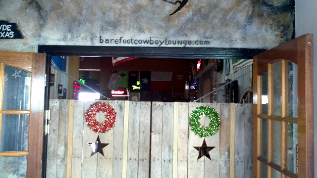swinging doors in The Barefoot Cowboy Lounge